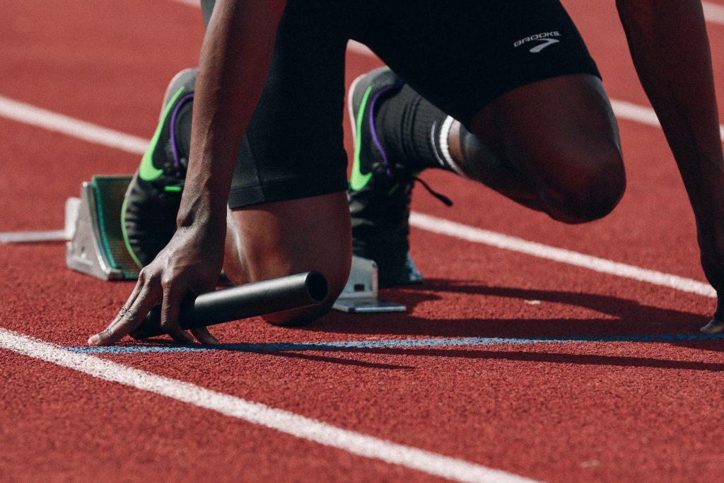 Sprinter crouching in the starting blocks